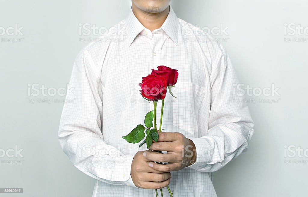 Men holding a roses royalty-free stock photo