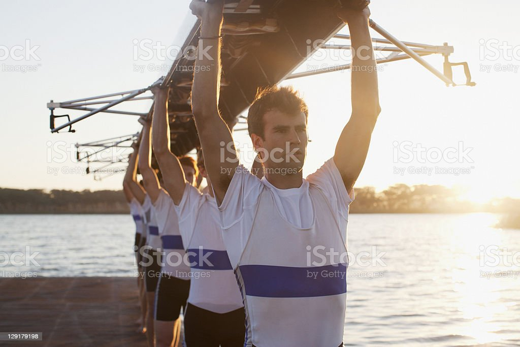 Men holding canoe overhead royalty-free stock photo