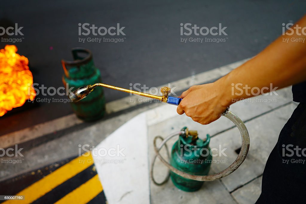 Men holding gas nozzle stock photo