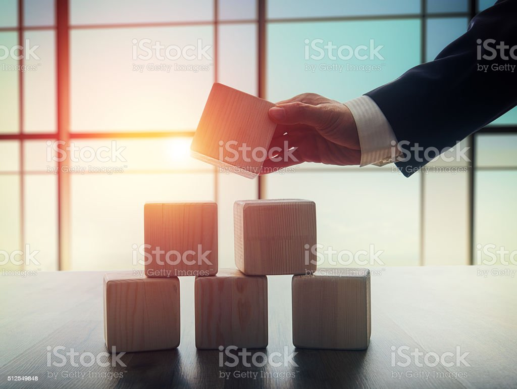 men holding the cubes stock photo
