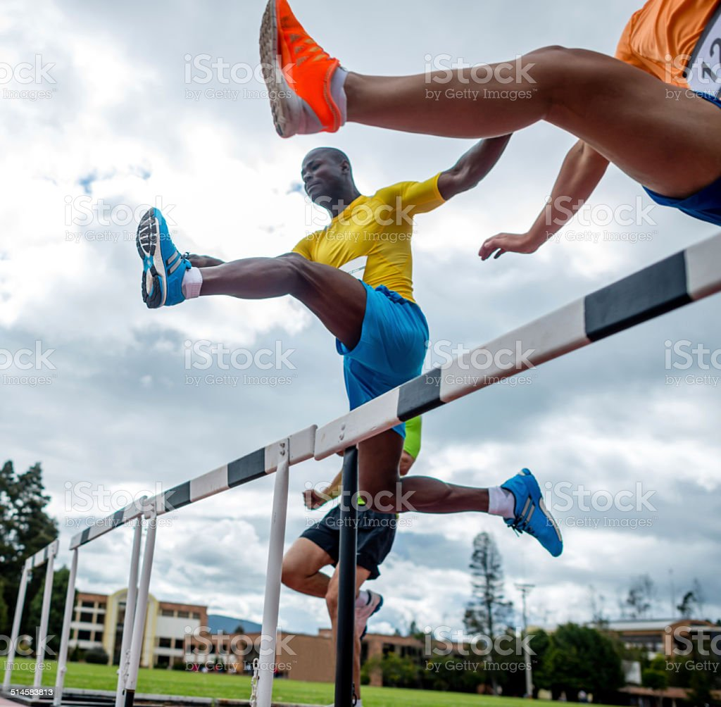 Men hurdling stock photo