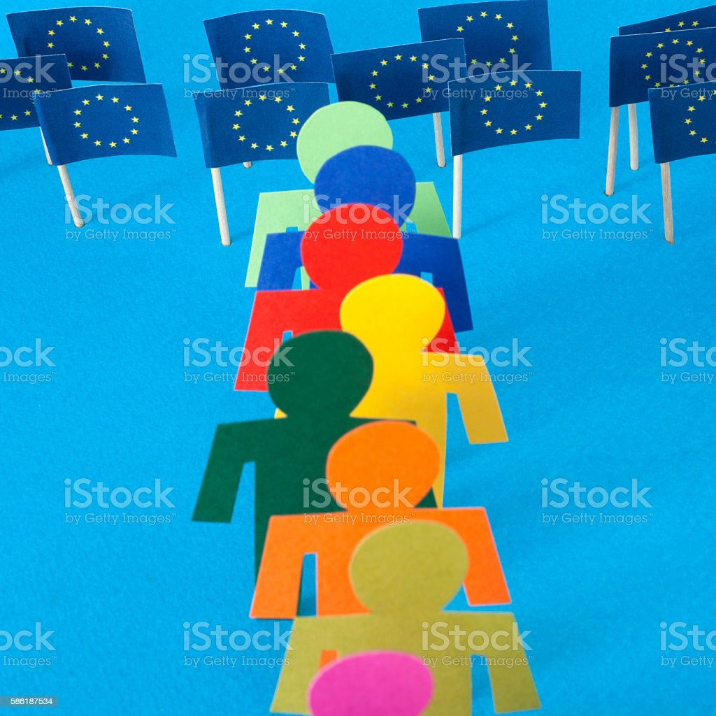 Men in a row standing in front of european union flags stock photo