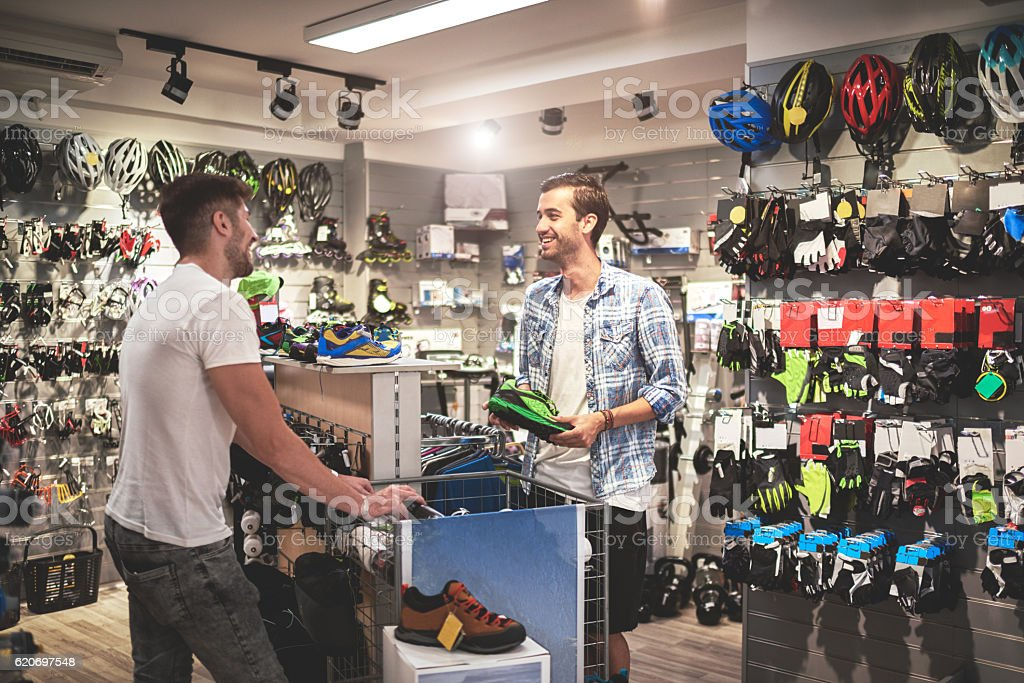 Men in bicycle store stock photo