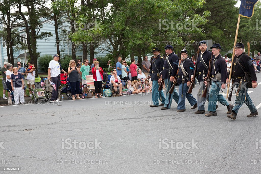 Men in Civil War uniforms march in July 4th parade stock photo