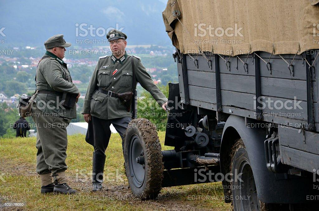 Men in german uniforms during historical reenactment of WW2 battle stock photo