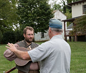 Men in historical costumes participating in the Warrenton-Fauquier Heritage Day