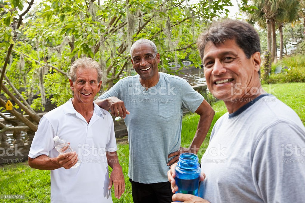 Men in park after exercising stock photo
