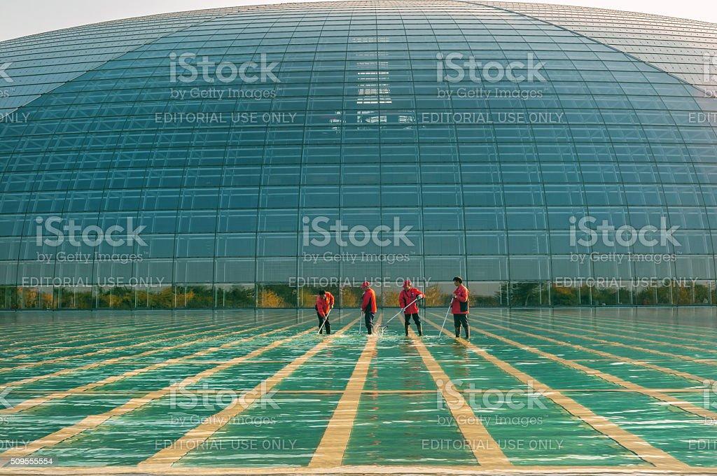 Men in Red Working Beijing Opera House, Beijing,China stock photo