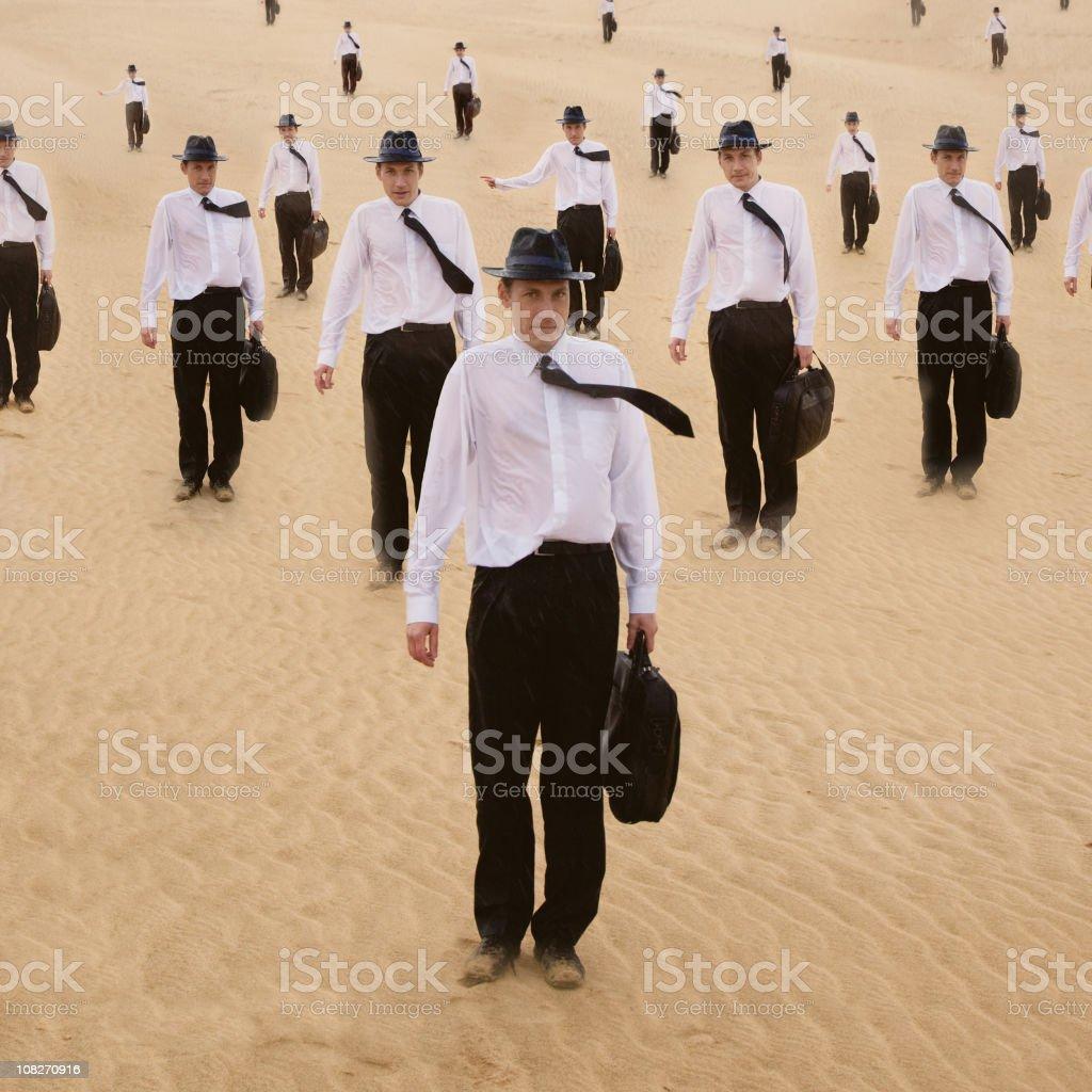 Men in sands series stock photo