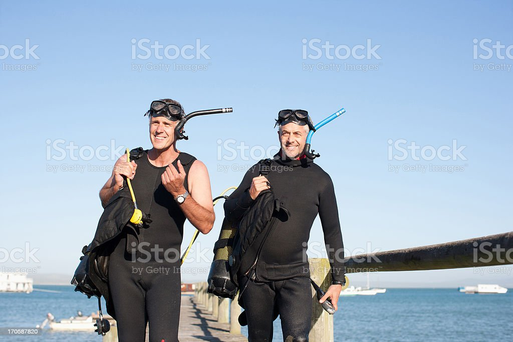 Men in scuba gear stock photo