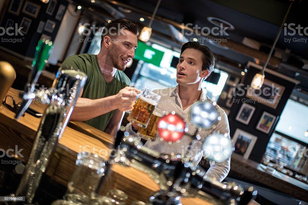 Men in the bar stock photo