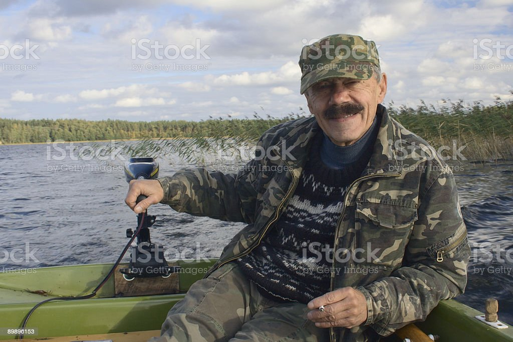 Men in the motorboat royalty-free stock photo