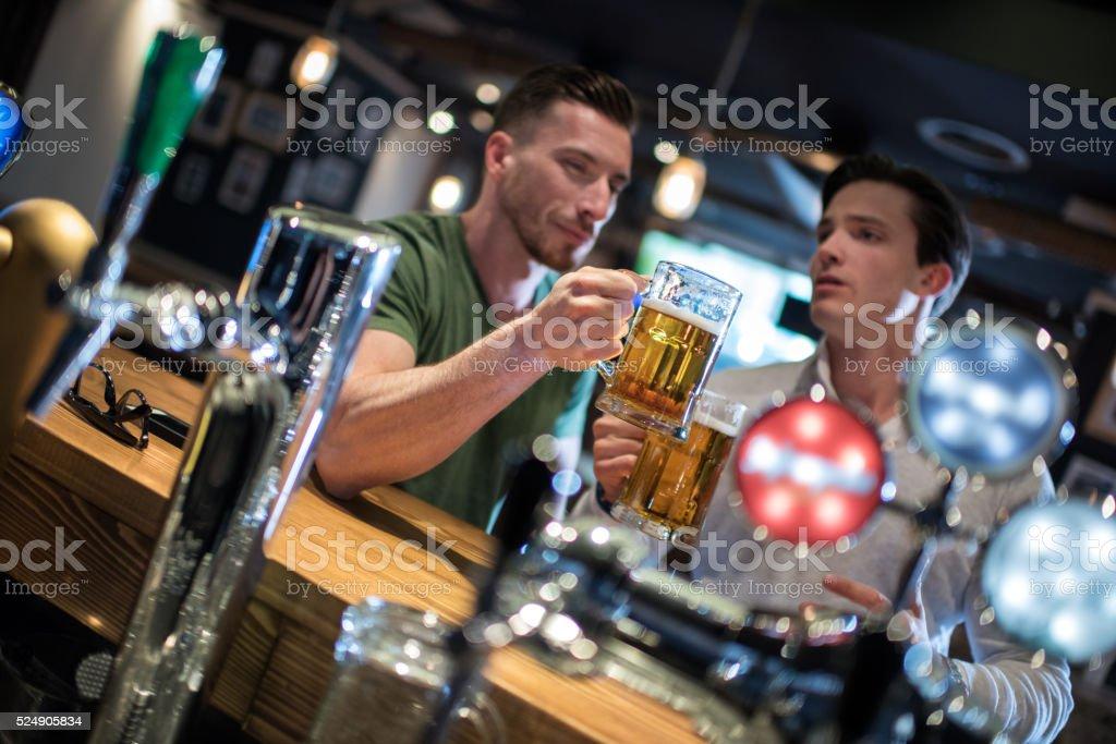 Men in the pub stock photo
