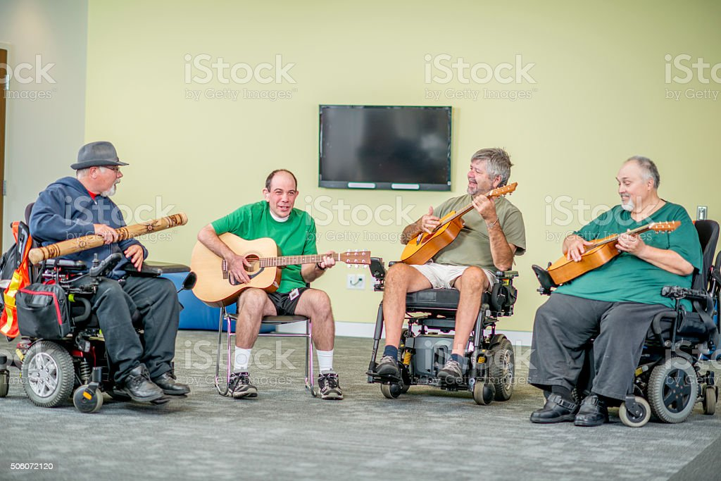 Men in Wheelchairs Playing Music stock photo