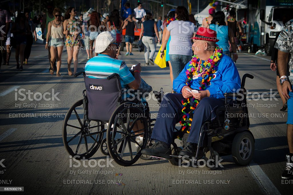 Men in wheelchairs talking stock photo