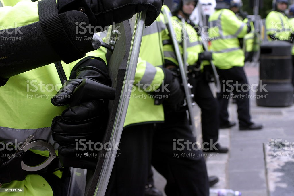 Men in yellow vests blocking the way stock photo