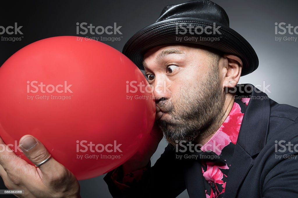 Men inflated the balloon to hard stock photo