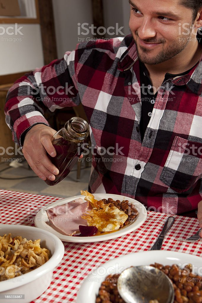 Men is pouring maple syrup royalty-free stock photo