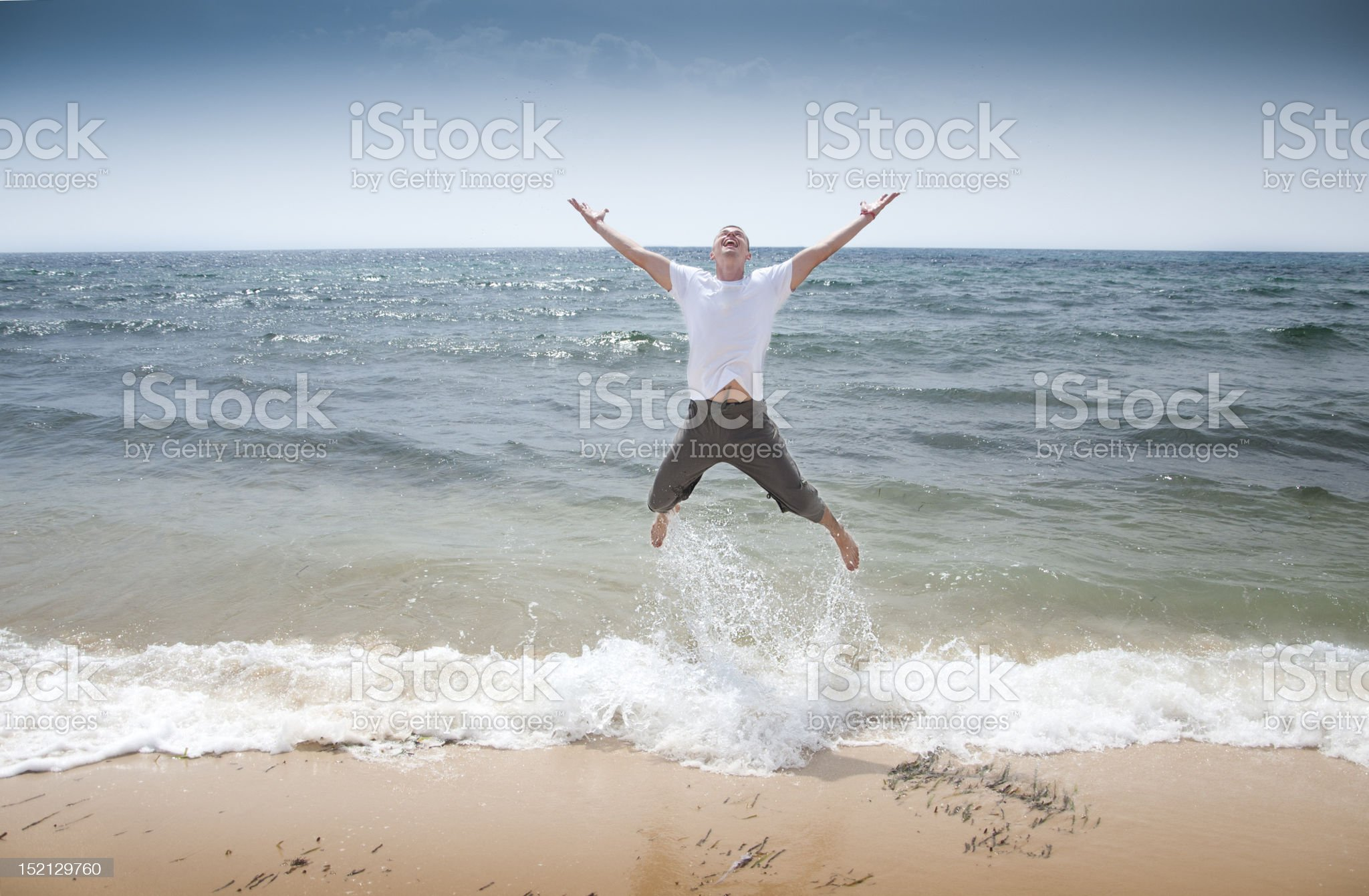 Men jumping on the beach royalty-free stock photo