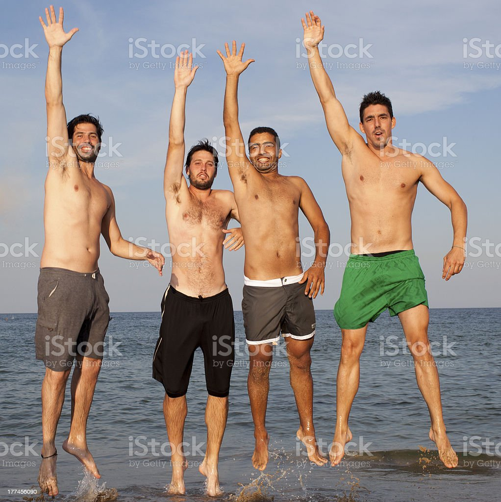 men jumping with arm up royalty-free stock photo