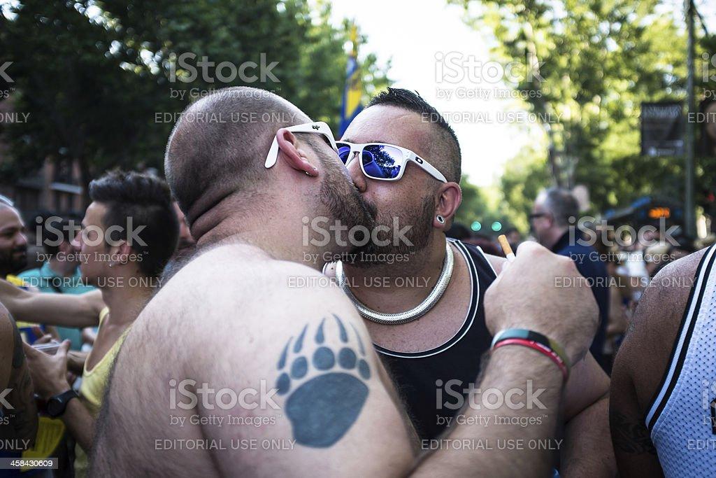 Men kissing at the Gay Pride parade in Madrid royalty-free stock photo