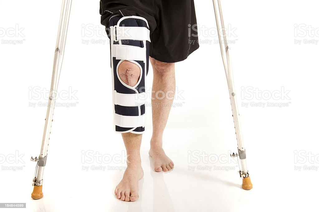 men knee after surgery with brace royalty-free stock photo