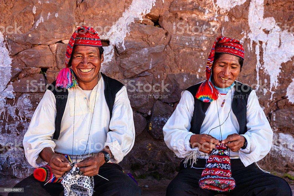 Men knitting on Taquile Island, Lake Titicaca, Peru stock photo