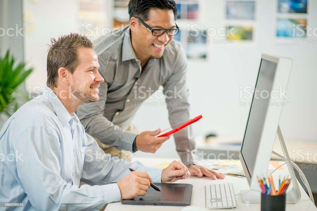 Men Laughing Together at the Office stock photo