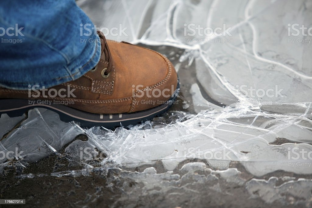men leg in shoe crushing thin ice stock photo