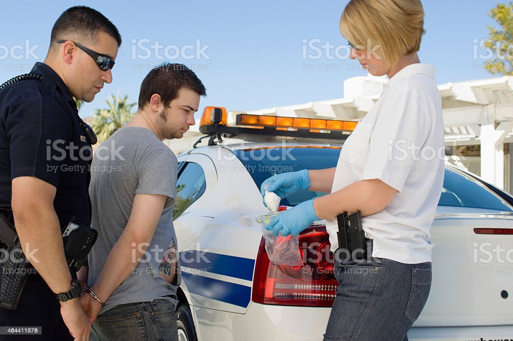 Men Looking At Drug Packet stock photo