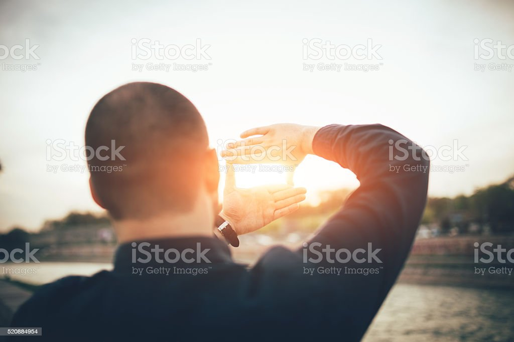 Men Making A Composition Frame stock photo