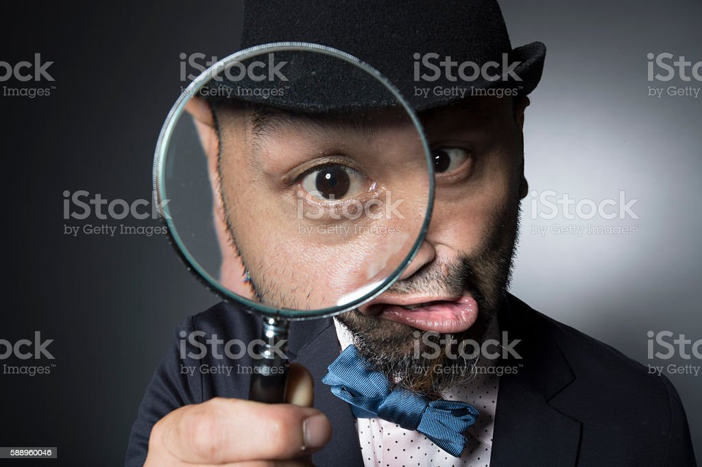 Men observing the eyeball in the magnifying glass stock photo
