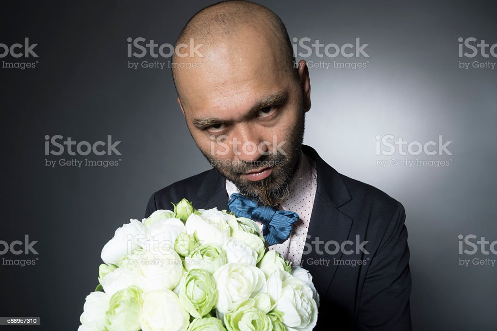 Men of skin head to have a bouquet stock photo