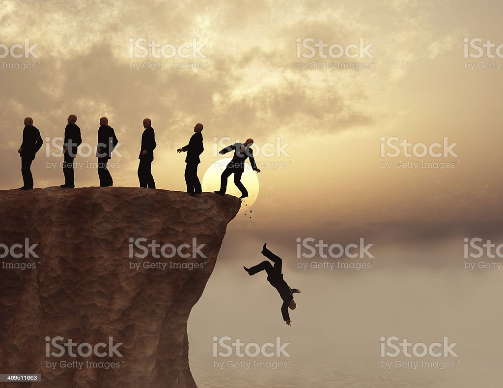 Men on a cliff stock photo