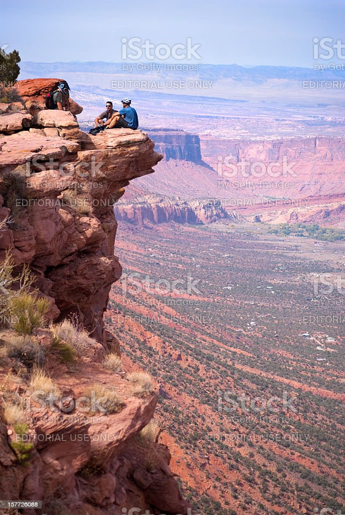 men on cliff and desert badlands landscape royalty-free stock photo