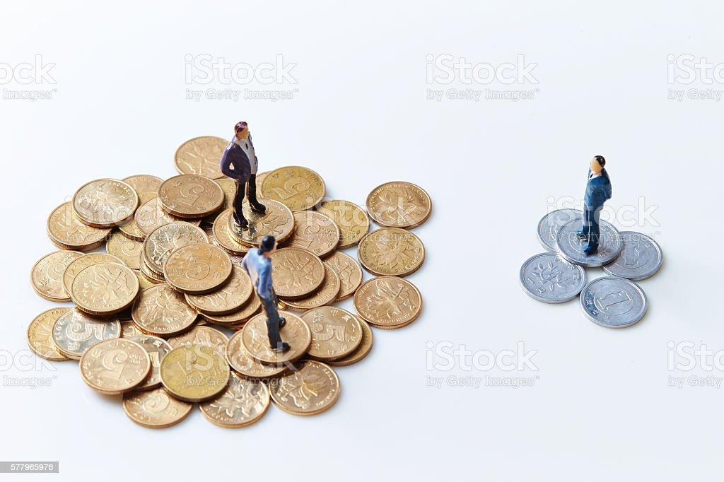 Men on coins stock photo