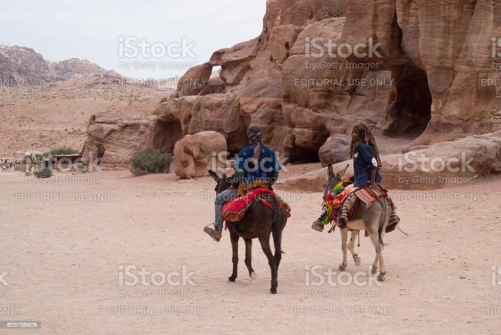 Men on donkeys, Petra, Jordan stock photo
