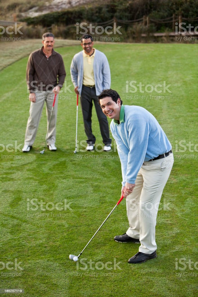 Men on golf course teeing off royalty-free stock photo