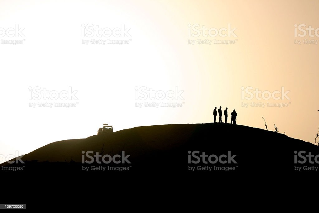 men on the hill stock photo