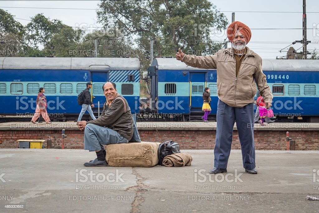 Men on train station stock photo
