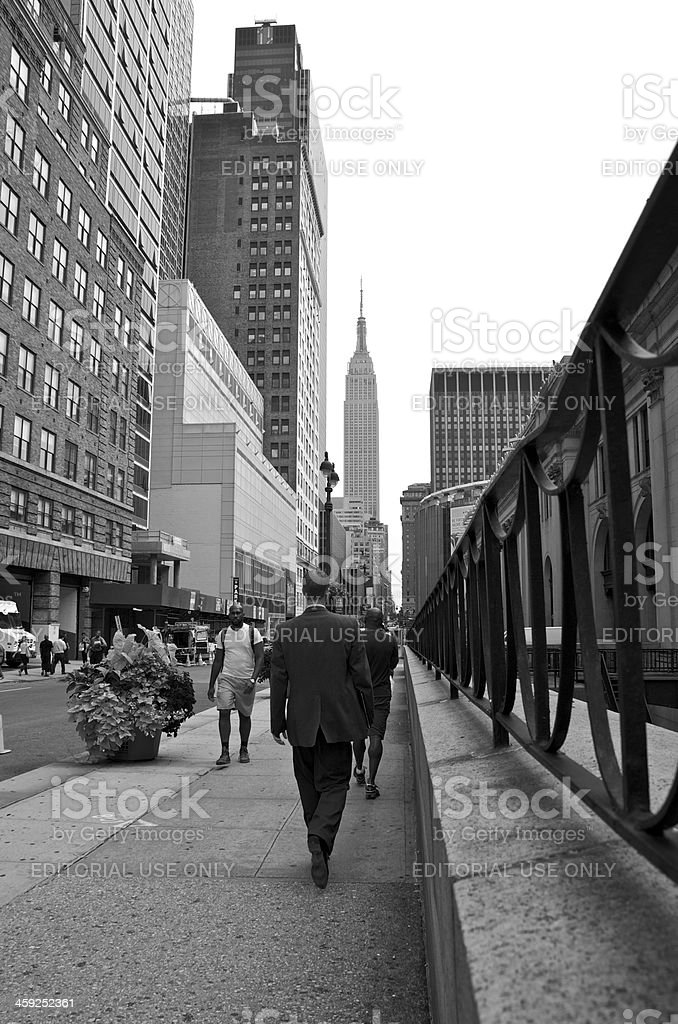 Men on W.33rd Street, Empire State Building Cityscape, Manhattan, NYC stock photo