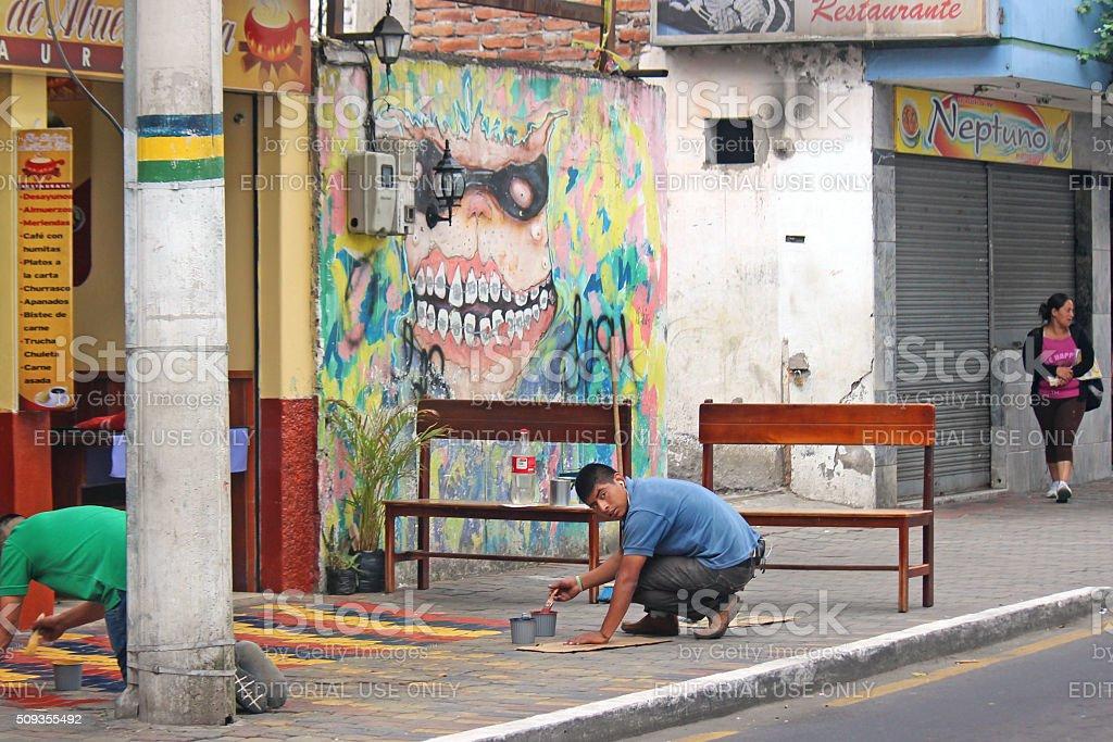 Men Painting Sidewalk - Baños, Ecuador stock photo