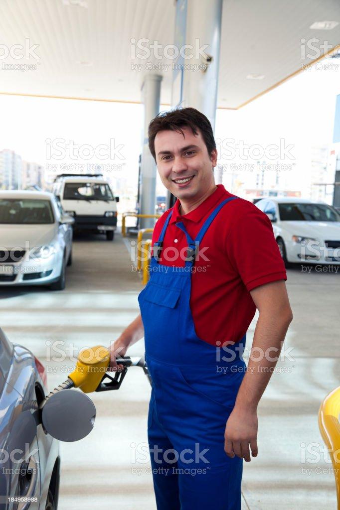 Men petrol filling stock photo