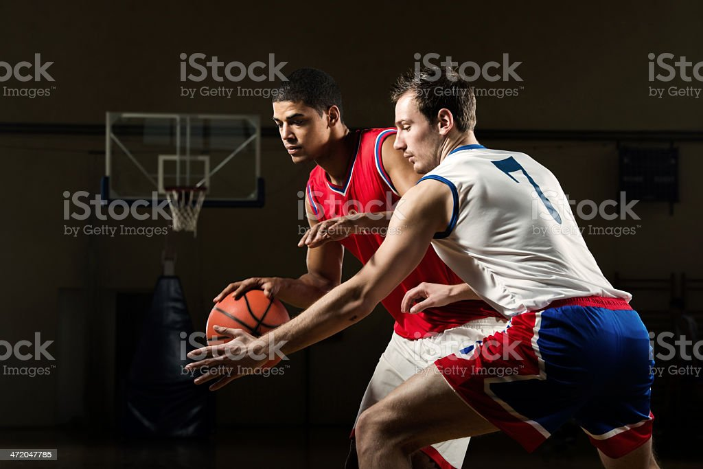 Men playing basketball. stock photo