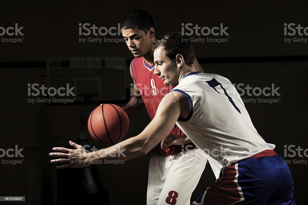 Men playing basketball. royalty-free stock photo