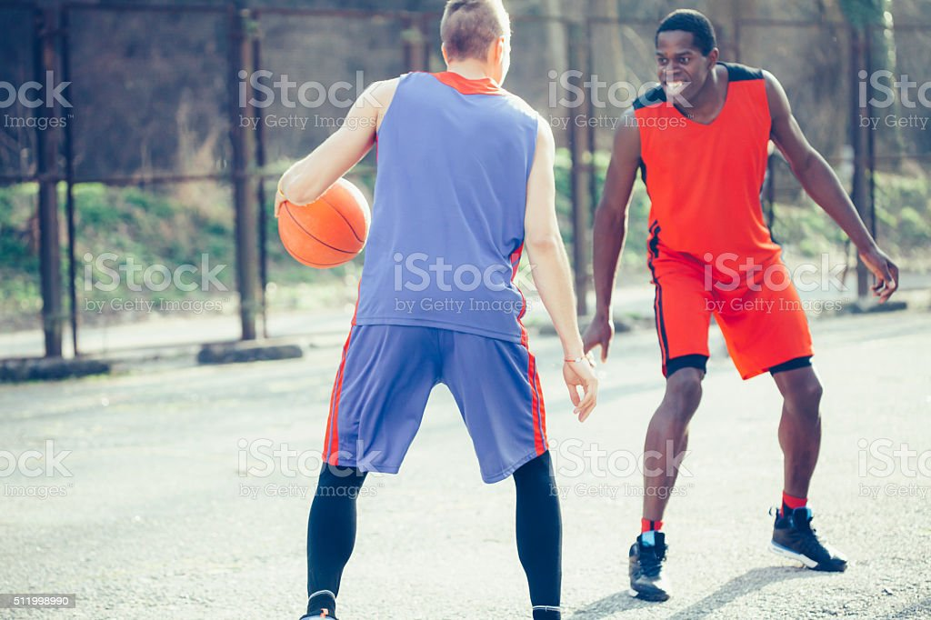 Men playing basketball stock photo