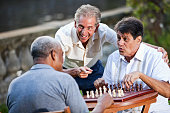 Men playing chess in park