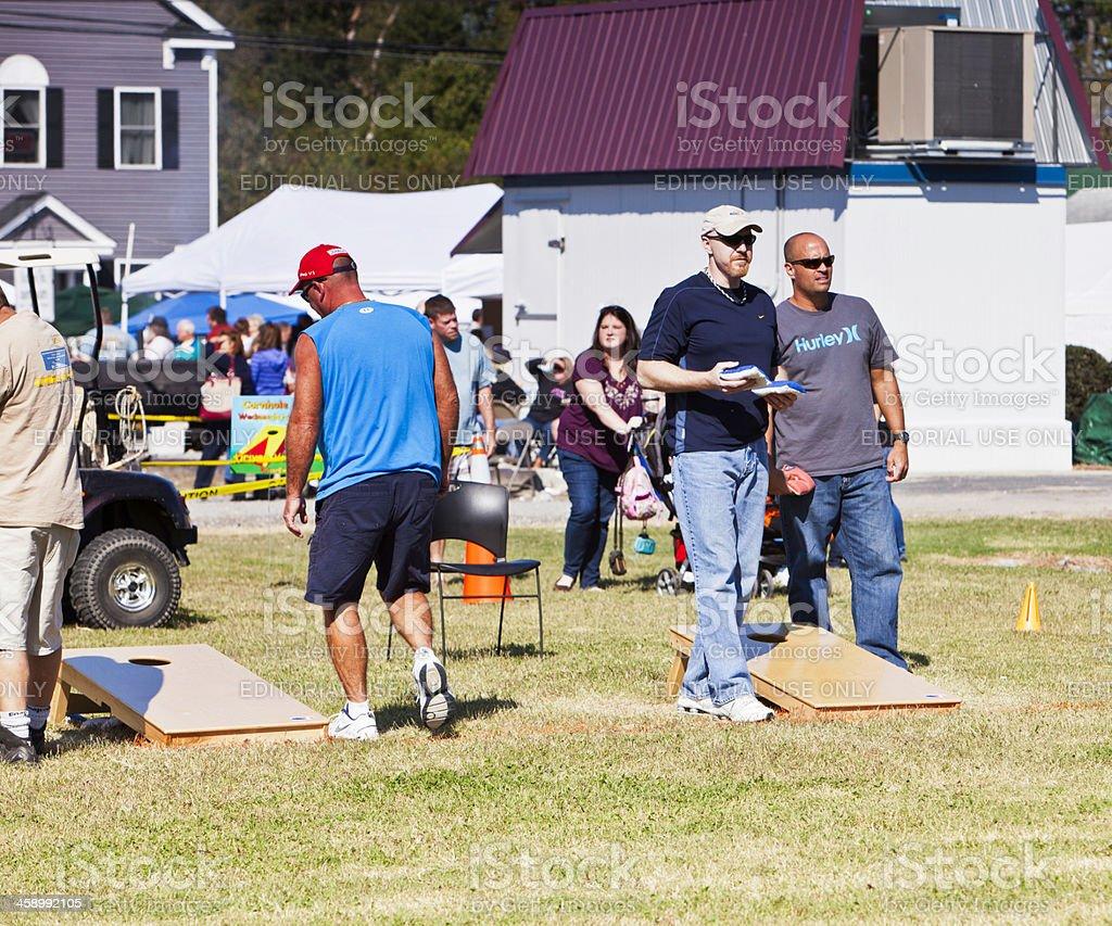 Men Playing Cornhole stock photo