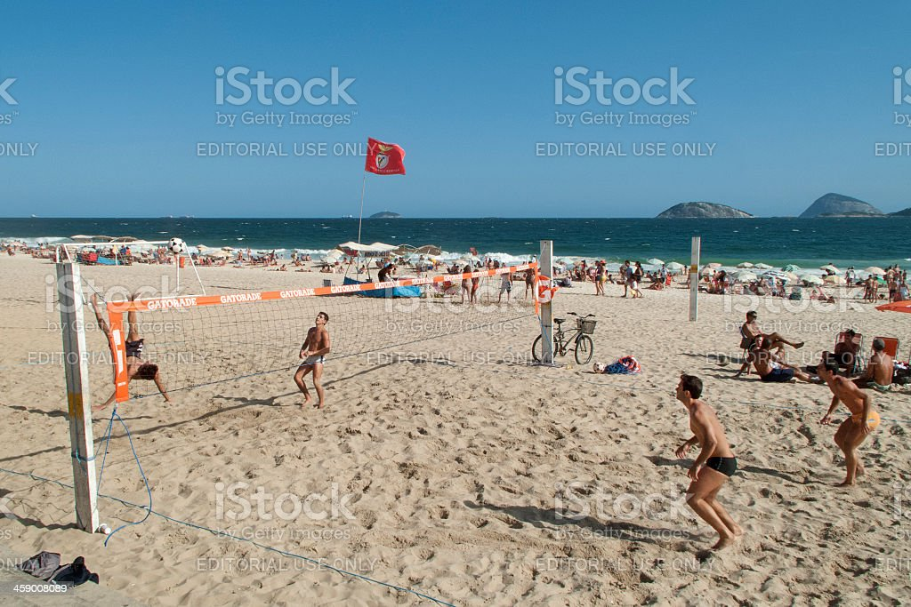 Men playing footvolley in Ipanema Beach stock photo