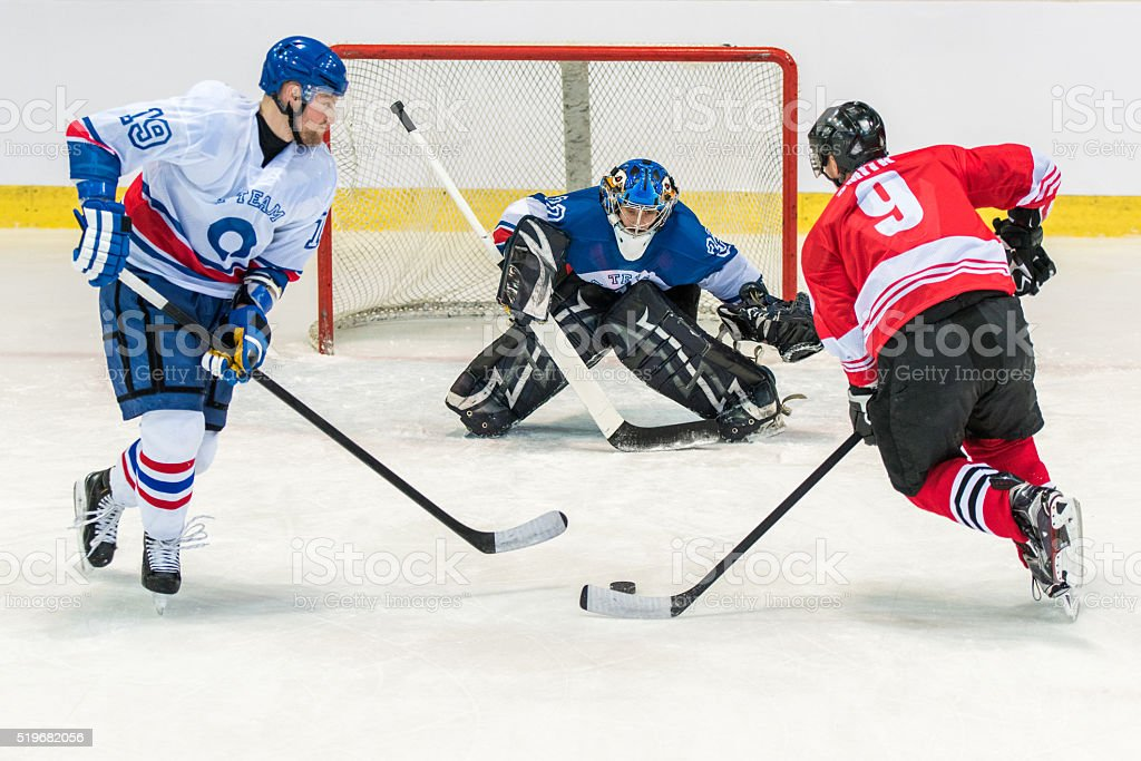 Men playing ice hockey stock photo
